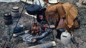 Mountain Men Food Preparing a Meal over an open fire with rudimentary tools