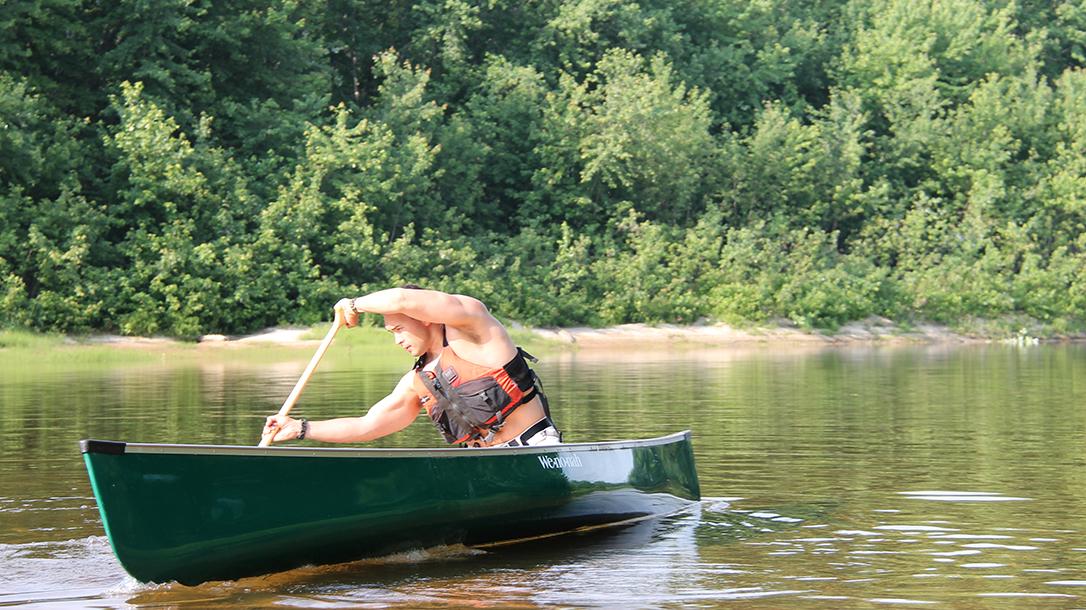 Canoe paddling J-stroke on one side