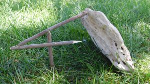 figure-four deadfall trap, deadfall, grass, rock, sticks