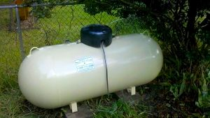 Large tank, propane, yard, fence