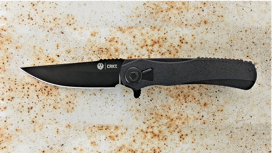 CRKT RTD folding knife on a metal rusted table