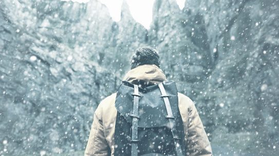 Survival Thermodynamics, man hiking in the snow