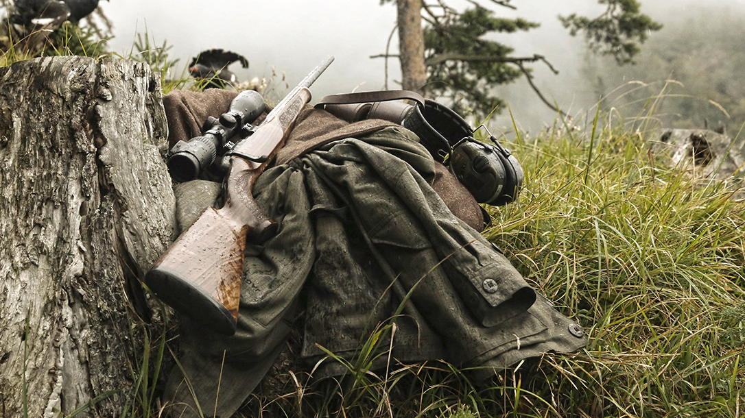 rifle, jacket, overcast field