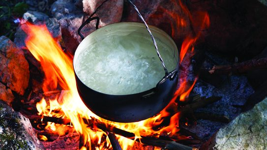 Disinfecting water, boiling, pot over fire