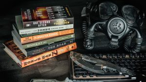 survival books, keyboard, knives and a gas mask
