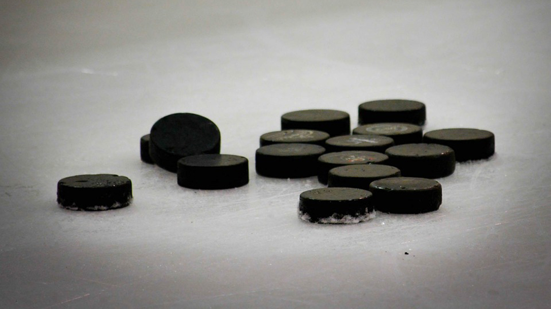 hockey pucks on ice