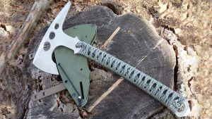 tomahawk on a stump, green sheath