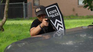 police shield gun drawn behind car