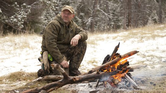 Survivorman Les Stroud by a fire
