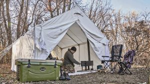 wall tent, cooler, sheepherder's stove, trees