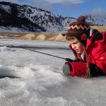 ice fishing, ice hole, boy with a fishing pole