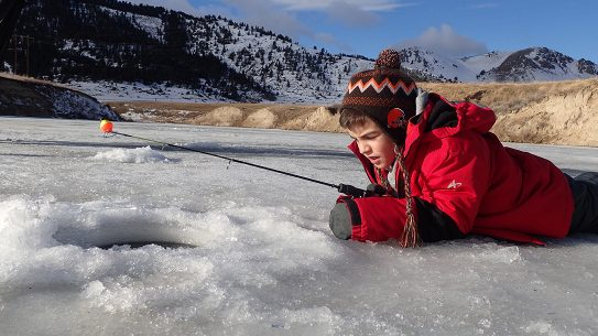 ice fishing, ice hole, boy with a fishing pole