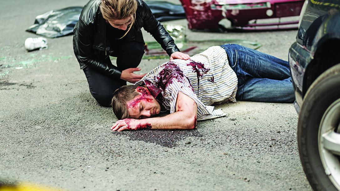 hemorrhaging man, street, first aid