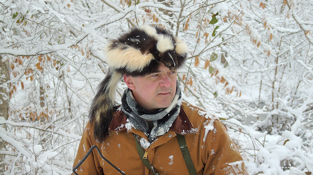 Skunk Skin Cap, man wearing the cap in snow