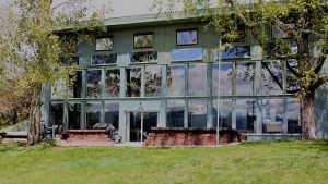 passive solar home, windows, trees