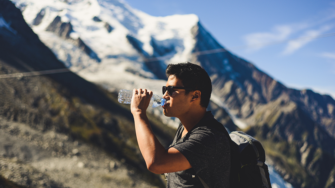 drinking water, hiking, mountains