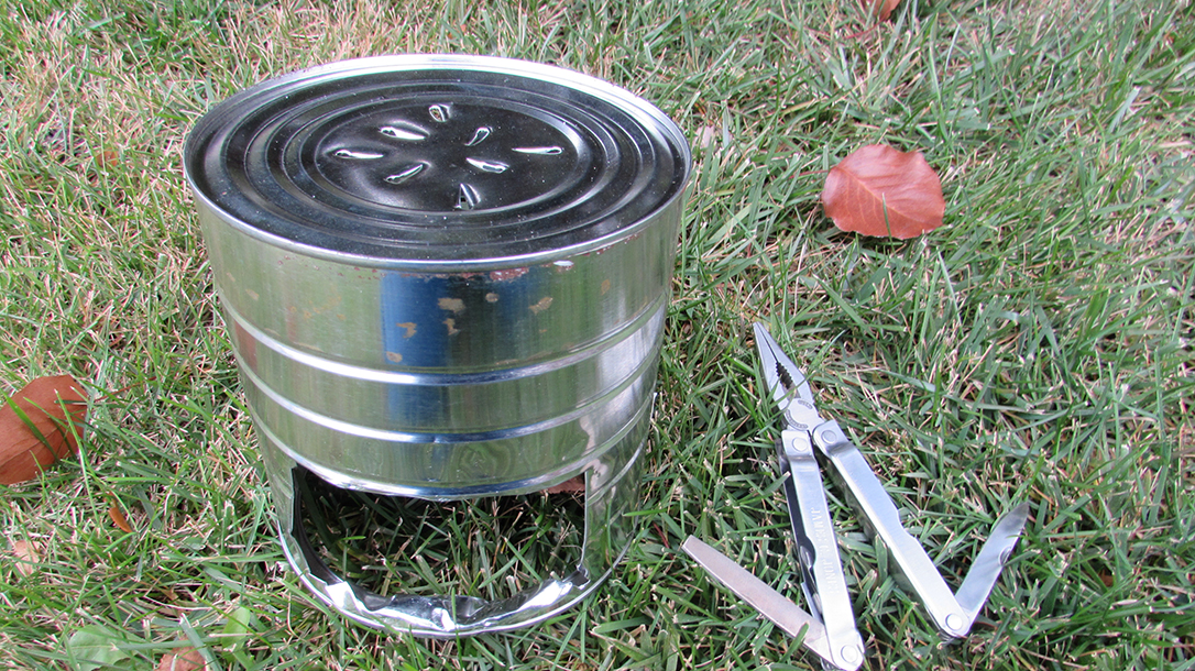 Hobo Stove, multitool, on grass