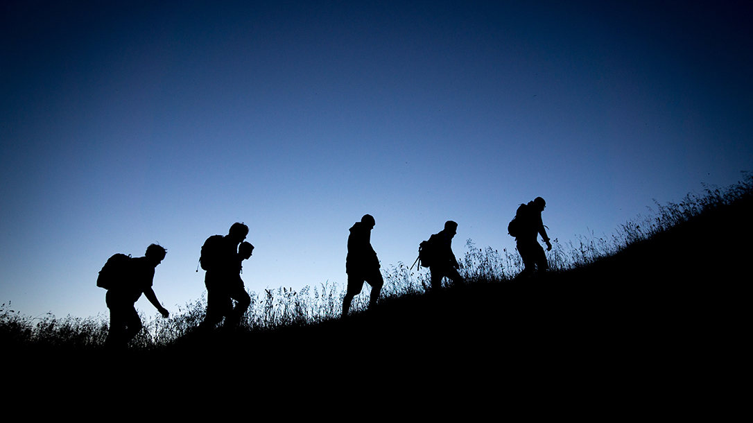 hiking, silhouette. blue sky