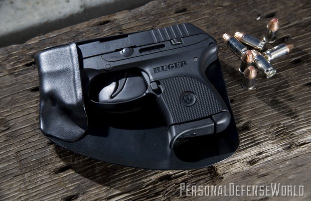 "The innovative design of Recluse holsters eliminates any ""printing."" The handgun is holstered by placing the muzzle into the pouch and then bringing it into place from the side"