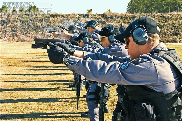 Officers on the range, training with the Glock 22 pistol and Diemaco C8 battle rifle. Officers must be trained to respond to a variety of situations with varying degrees of force to stop the perceived threat.