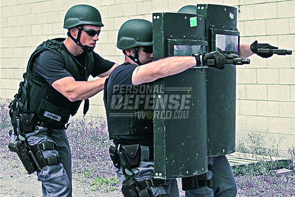 Officers train for a variety of threats. Officers demonstrate effective use of the Glock 22 pistol from behind ballistic shields.