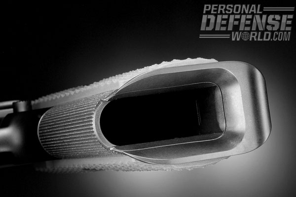 The bottom of the frontstrap is well-beveled to avoid cutting up your hands, and the bottom of the mag chute is fitted with a mag funnel that's machined of a single piece of steel with the mainspring housing.