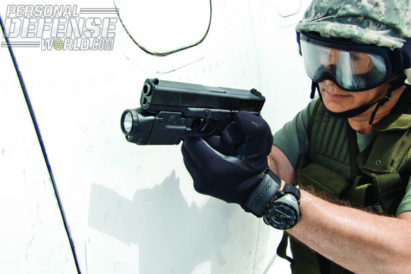 The Gen4 GLOCK makes an outstanding weapon for officers who wear tactical gloves on a regular basis as the finish practically adheres to the glove, preventing slippage or loss in adverse conditions, such as assaulting an aircraft. The author is shown here during aircraft assault training on a Boeing 727 at Columbus State Community College in Columbus, Ohio, ready to conduct a wing breach with a 9x19 GLOCK and GLOCK Tactical Laser Light combo.