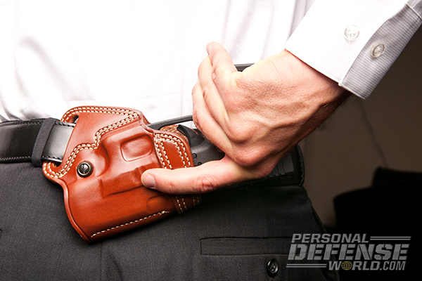 Hideaway Holsters: 8 Ways to Covertly Carry Your Weapon - Small Of The Back Carry