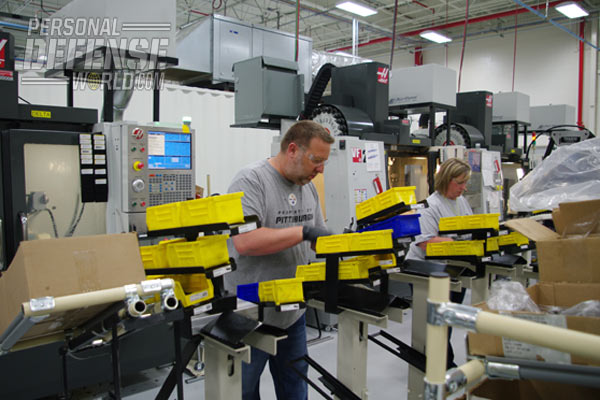 "Employees in the ""super cells"" work closely together to produce the rifles."
