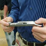 """An """"in the white"""" American Rimfire receiver pulled from the production line for inspection by the visiting group."""