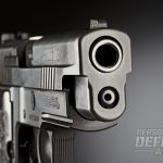 The business end of the P226 Elite's 4.4-inch match-grade barrel. Note the forward slide serrations.