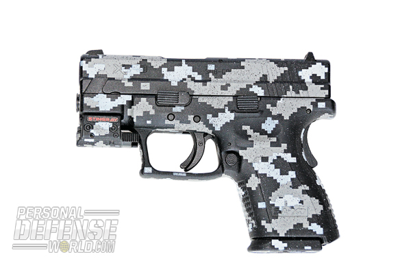 The author's camo-DuraCoated Springfield XD pistol.