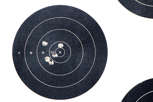 """Shooting from a rest at 25 yards, I achieved my best five-shot group with Remington's 36-grain Golden Bullet plated hollow-point load—0.88 inches."""