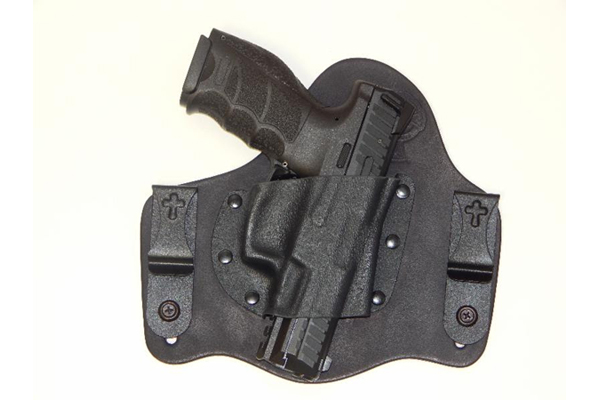 The Heckler & Koch VP9 is shown below holstered in a SuperTuck by CrossBreed.