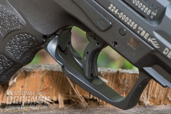 Within the VP9's trigger is a paddle safety that must be depressed before the pistol can fire.