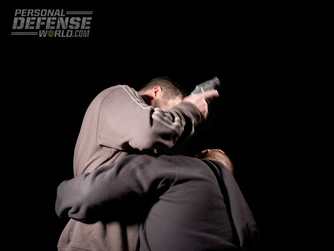 Proper pistol punching technique combines a solid weapon-retention position with the idea of thrusting with the straight trigger finger to generate a powerful, accurate strike.