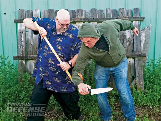 walking cane, cane, walking cane self defense, cane self defense, less-lethal weapon, less-lethal, less lethal, walking cane defense