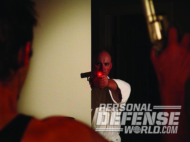 armed homeowner gun laser