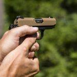 Kimber Micro 9 Desert Tan pistol aiming