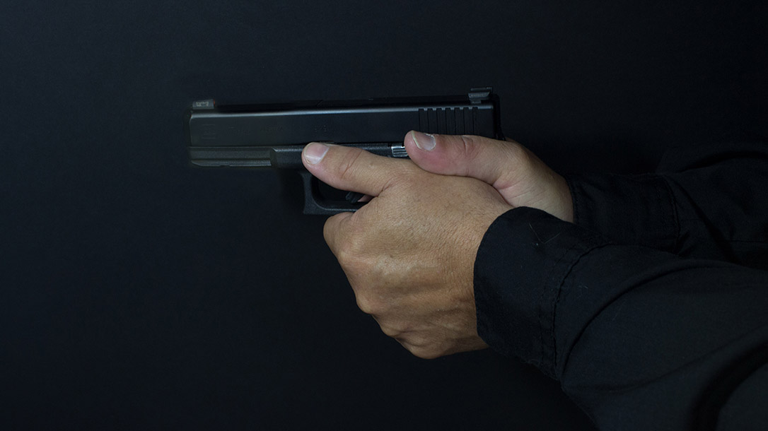 Pistol grip ways to hold a handgun thumbs forward