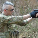Steyr L40-A1 pistol aiming