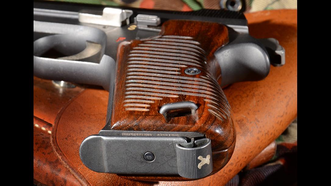 Sig P210 Target pistol magazine release
