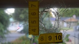 washington teen home intruder bullet hole
