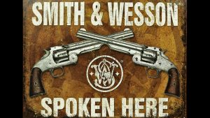 Smith & Wesson Spoken Here sign, suspect shot