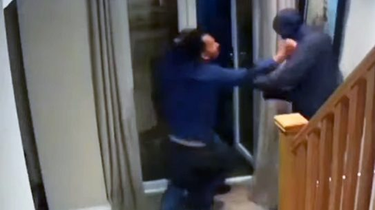 An English man fought off masked home intruders.