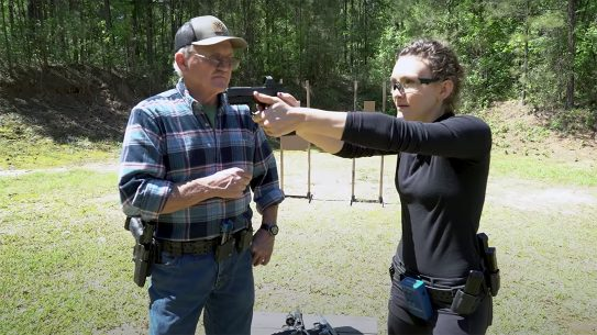 Jerry and Lena Miculek discuss switching from irons to optics.