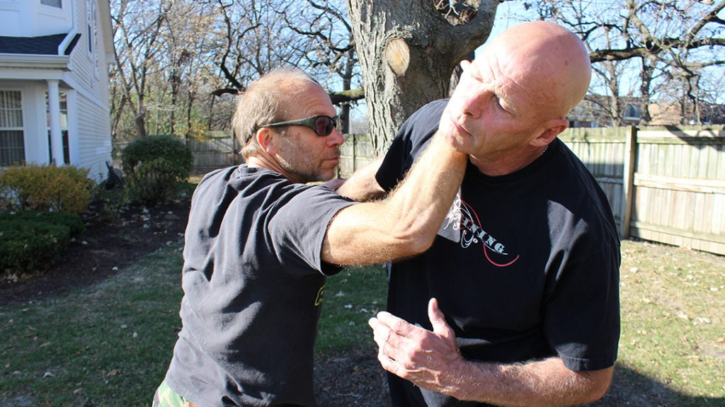 Immediately thrust your forearm into your attacker's carotid artery on the side of his neck.
