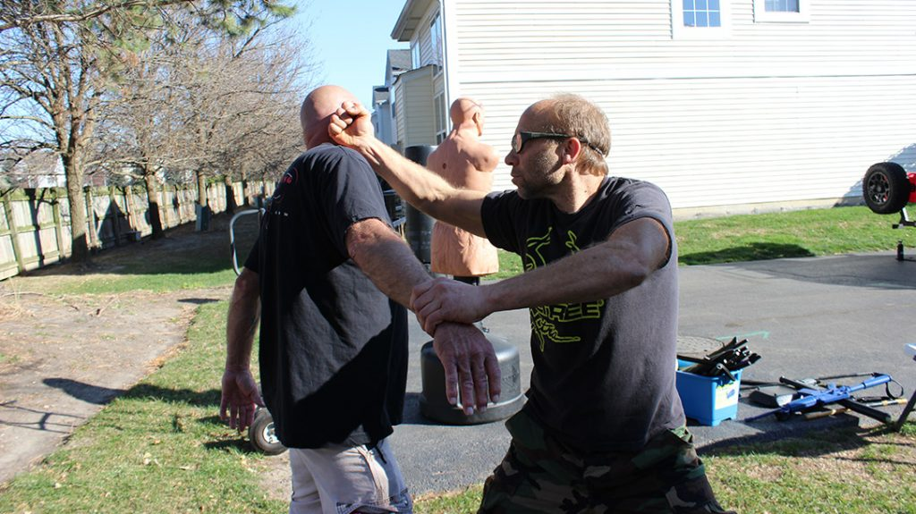 Always follow up with attacks until the fight is done. Pictured is a backfist to the ear/side of the face.