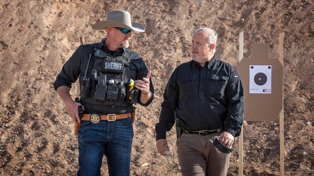 The author walks with Sheriff Mark Lamb on the range.