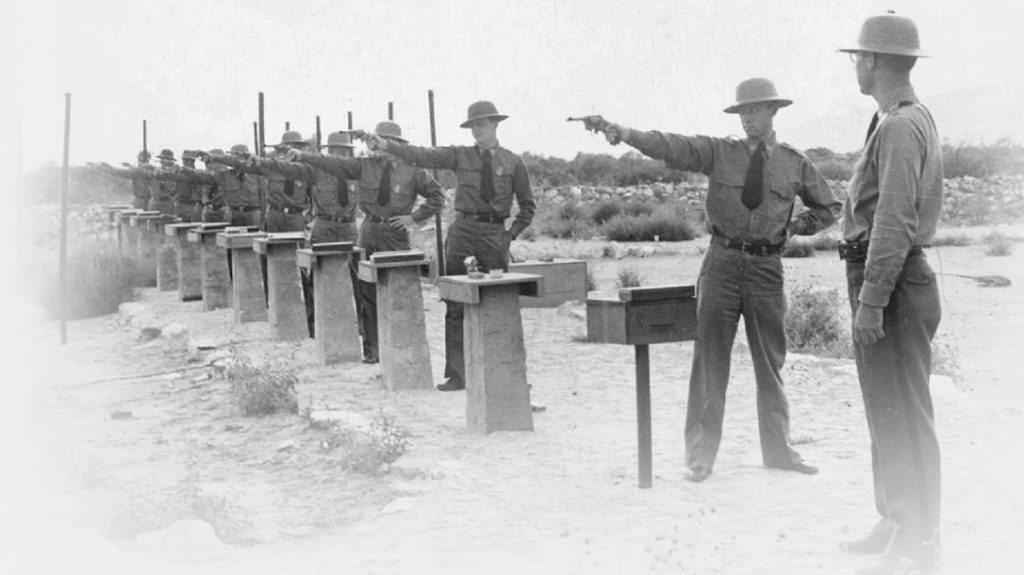 Old photo of law enforcement training with the .38, using a single hand stance.